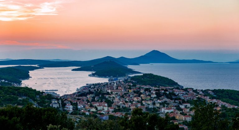 High angle view of amazing panorama. Seaside town, island, sunset. Mali Losinj, Croatia.